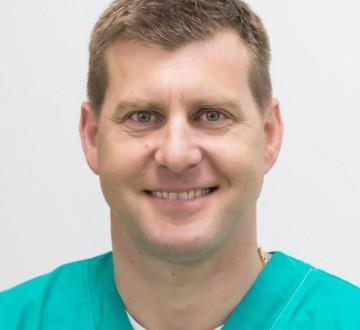 Olaf John, dr.med. dent., spec. oralni kirurg